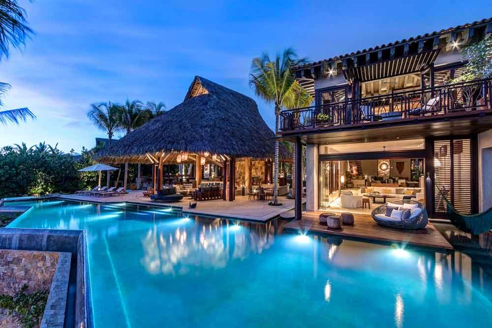 Photo of lit room, patio and pool at Luxury Casa Koko, Punta Mita, Mexico