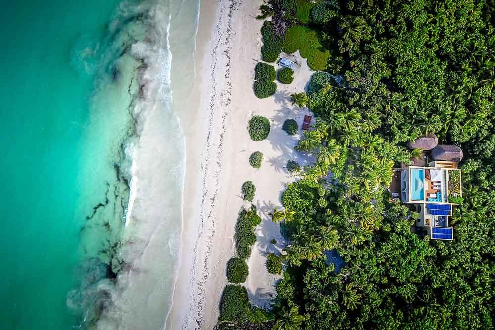 Aerial shot of beach line and tropics in Hacienda, Chekul, Mexico