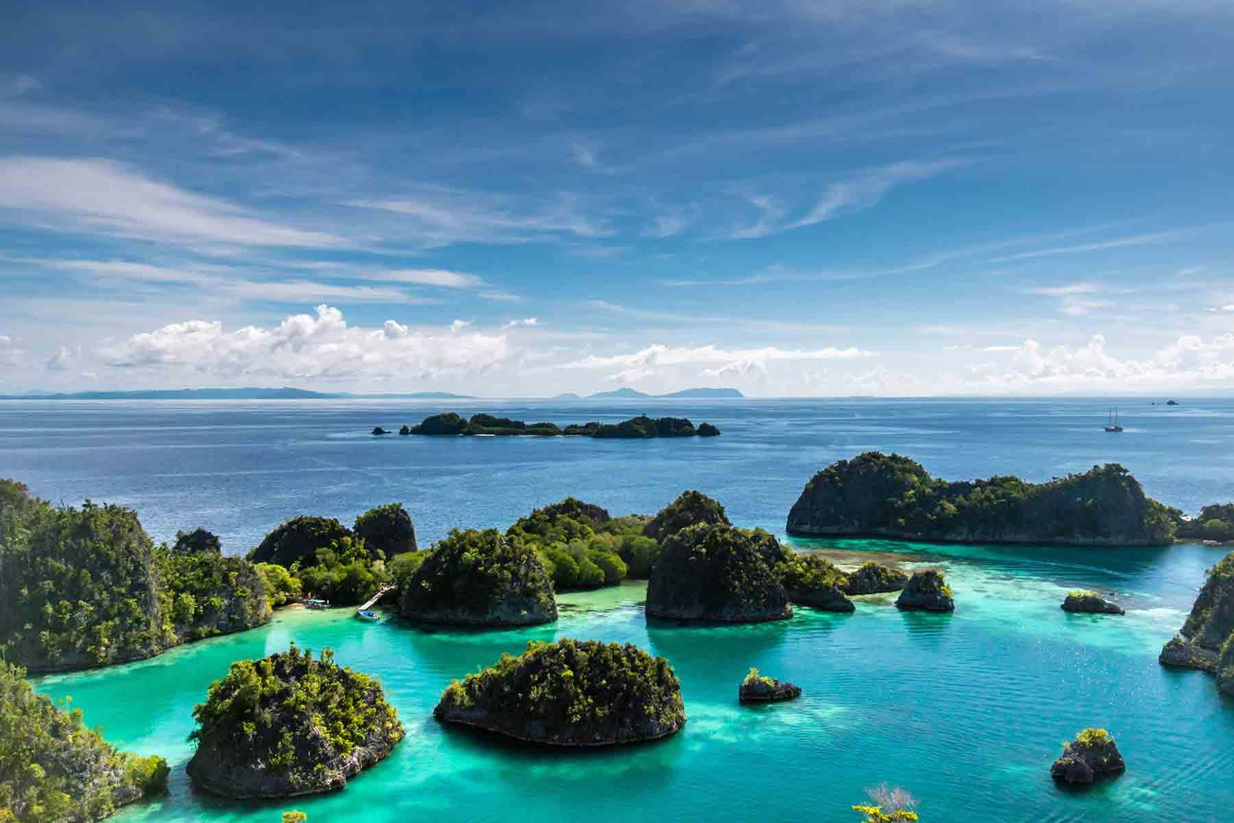 Small green islands in blue water