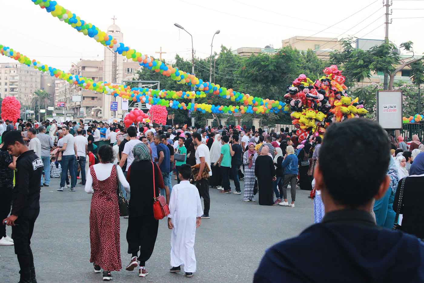 Photo of people walking down the streets of Cairo, Egypt during a festival