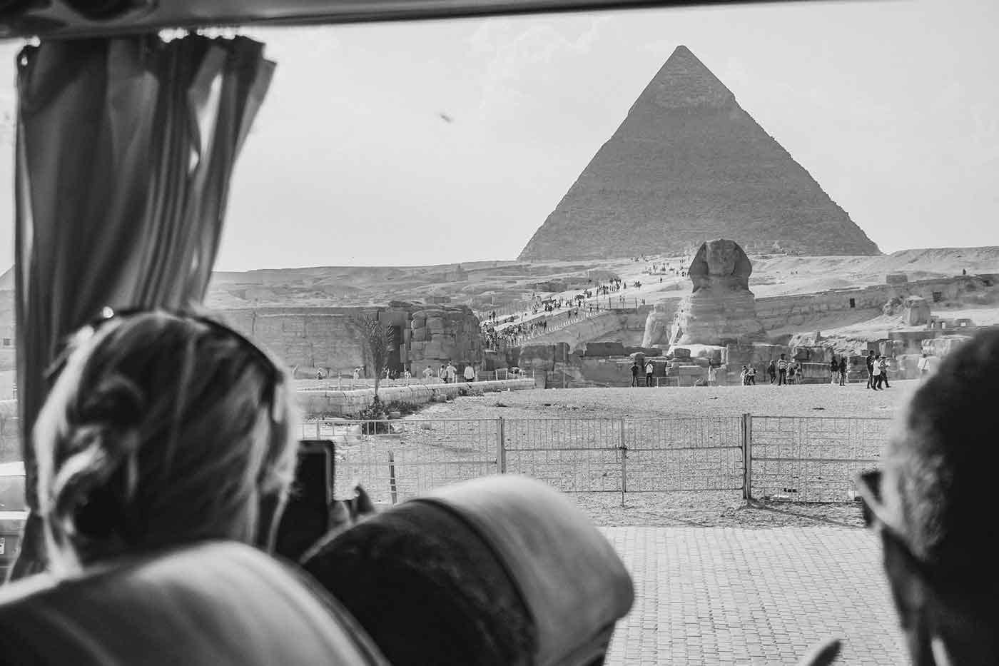 Photo of people on a bus tour viewing Egyptian pyramids