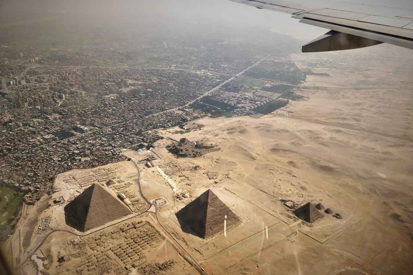 Aerial photo from airplane flying over pyramids and city of Cairo, Egypt