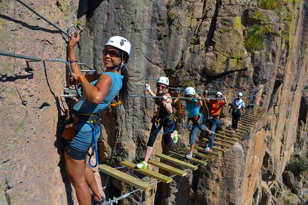 Photo of people on guided rock mountain adventure in Copper Canyon, Mexico