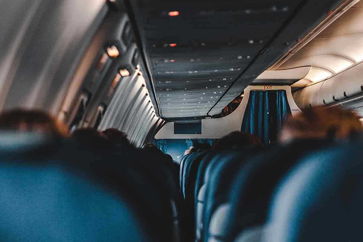 Photo of interior of coach seating on airplane