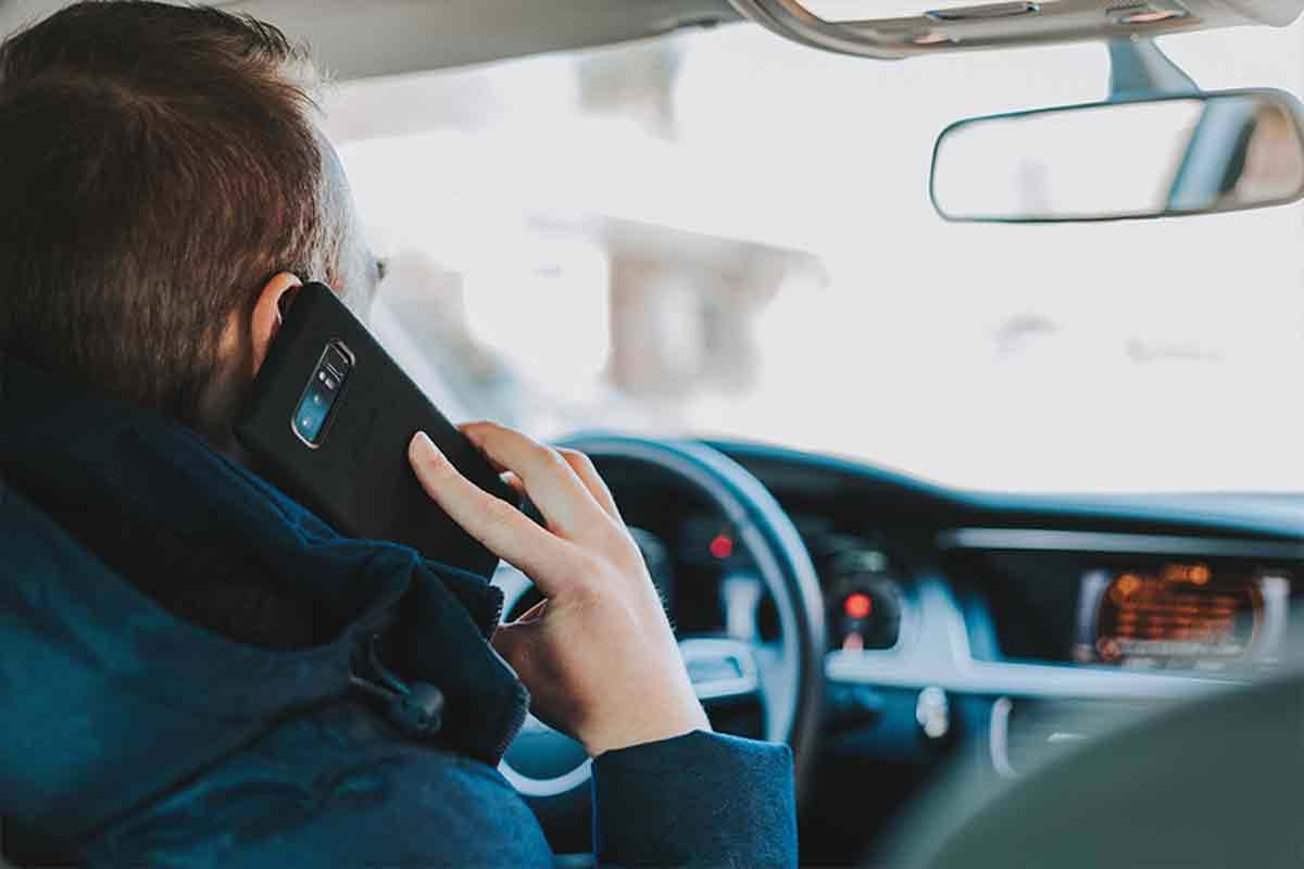 Photo of man on cell phone while driving